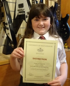 Sophie Passes with Distinction Registry of Guitar Tutors